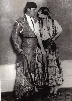 """Pola Negri and Rudolph Valentino, from a costume party held by Marion Davies and William R. Hearst at Hearst Castle. Valentino was dressed as the """"Blood and Sand"""" matador and Negri came dressed as an officer-of-the-guard for Catherine the Great. She was reportedly ( but really wasn't  ) Valentino's lover until his death in 1926."""