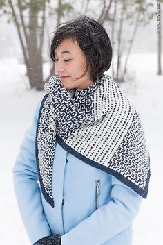 """This shawl design was inspired by two things: one, Akira Kurosawa's film """"Yojimbo"""", (a personal favorite), and two, a desire to interpret elements of Japanese Sashiko embroidery in knitted color work. Many Sashiko motifs are evocative of natural features such as mountains, mountain trails and still and flowing water. I imagined a thrifty Japanese housewife salvaging useful kimono scraps to make a handy and beautiful wrap to wear on cold, rainy days."""