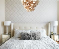 Bedroom with white and silver wallpaper, capiz shell chandelier, white bedspread and leather headboard and mirrored side tables - LUX Design