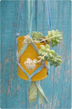 Gleeful Things » DIY Tutorial: Plant Hanger From Fabric Strips  I have two mini kegs with great graphics and a spigot for drainage that'll work great for this!