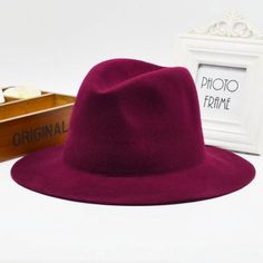 Item Type: Fedoras Pattern Type: Solid Department Name: Adult Brand Name: fashion winter hats Style: Casual Gender: Women Material: Acrylic Material: Wool Model Number: px42 Color: black,Camel,winered