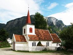 Undredal Church was built as a stave church in1147,rebuilt in 1700's. The smallest in NO.,seats 40. Aurlandsfjorden in Sogn.