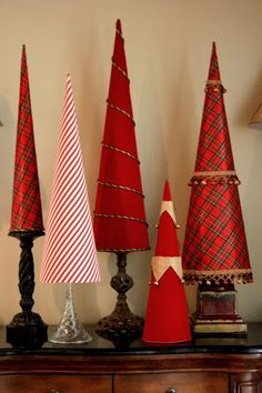 Get creative and crafty this Christmas with your holiday decor by using our tutorial to make beautiful DIY Christmas tree cones with poster board and fabric