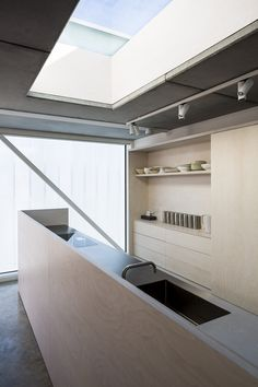 Kitchen in plywood and stainless steel in the Slip House by Carl Turner Architects, London