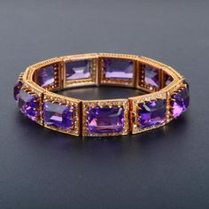Antique 18K rose gold bracelet with 11 links of rectangular shaped amethyst surrounded by diamonds with open gold work on the sides. 11 Amethyst total weight approx. 66ct 286 rose cut diamonds