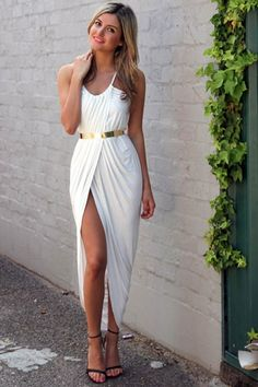 Get ready for summer in this super feminine maxi dress. Featuring scoop neck with spaghetti straps, ruched wrap front, irregular hem, deep slit front looks very sexy. Belt is not included.