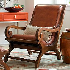 Curl up with a good book: the timeless form and endless comfort of the leather-and-teak Augusto chair and matching ottoman combine to make a work of art     that's also a pampering retreat. Skilled artisans have attended to every detail, from the braided leather stitching, to the hand-applied nailhead trim      a testament to fine quality and noble sensibilities of this traditional design. Add Augusto to the living room or the office and enjoy the     deeply reclining seat all while you ...