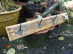 Handmade reclaimed pine rack with Arts & Crafts 'stick pegs' (Ref. SH0151), hooked on hooks