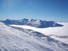 Southern Alps NZ poking up above the clouds  Photo taken from Treble Cone Skifield #landscape #southern #alps #poking #clouds #photo #treble #cone #skifield #photography