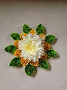 A real flower enhances the beauty of the quilled one