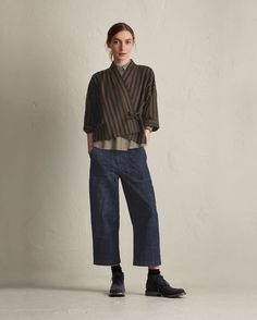 Kimono wrap-top in a lightweight cotton. Dropped shoulders and wide, below elbow-length sleeves. Fastens at the front with a tie at each side.