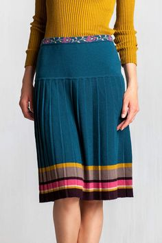 Fully pleated skirt that offers volume and motion featuring color block geometrical pattern, defined waist embellished with gentle floral pattern and hip-hugging silhouette that effortlessly flatters the figure.