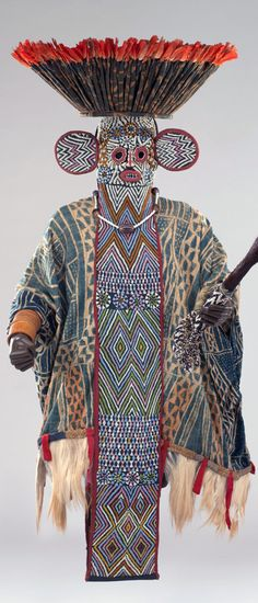 Africa | Mask Ensemble of the Kuosi Society Member. Bamileke people, Cameroon | ca. 19th - 20th century | Fabric, monkey fur, glass beads, feathers, reeds, string, horsetail, ivory
