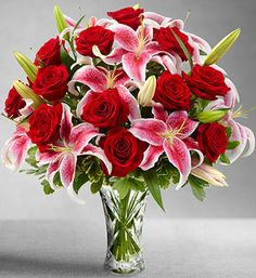 My favorite flowers...stargazer lilies and red roses...so pretty