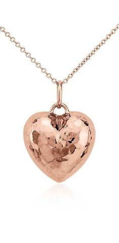 This heart pendant is crafted from hollow 14k rose gold for a dimensional look with a rich, hammered finish.