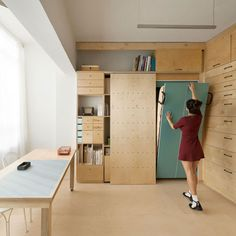 Architect Ranaan Stern has adapted a 15-square metre room in a Tel Aviv apartment for two desks, 36 drawers, storage, display walls and a folding bed.