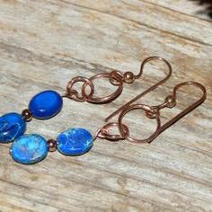 """""""Copper Mine"""" by Susen Foster - Small ovals of dark blue variscite, tiny copper beads and French fish hooks are presented with these beautiful earrings. A beautiful touch to any outfit."""