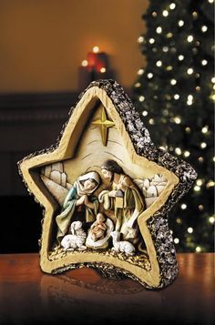 "Star Shaped Woodgrain Christmas Nativity Scene. Rustic and traditional nativity Christmas decoration. Measures at 8. 5"" W x 8"" H Made of resin  Avalon Gallery"