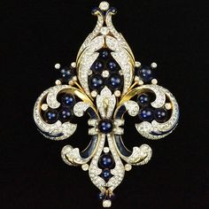 Trifari 'Alfred Philippe' Empress Eugenie Gold Black Enamel and Sapphires Fleur…