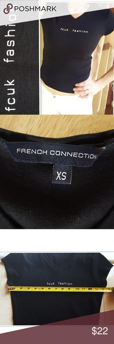 """FCUK Fashion French Connection UK Black Tee XS Rare FCUK /Fashion French Connection UK  Black Tiny Tee Tshirt XS  Size: XS Measurements (unstretched): Bust (from armpit to armpit): 14.5"""" Length: 19.5""""  My bust is 34-35"""" & I am modeling it in pic 1.  No fabric tag. Feels like a Cotton Blend. Has a bit of stretch to it.  In good pre-owned condition. Black is still dark, but a little wear to lettering. See 1st photo of close-up & other pics for condition.  * From a smoke-free (but 1…"""