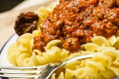 Slow Cooker Meaty Tomato Sauce - FANTASTIC sauce for any Italian dish!  www.GetCrocked.com