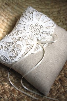 This is likely one of a kind, but I would imagine that this Etsy seller could create similar: Ava. Antique Lace Ring Bearer Pillow. Ready to Ship. Eco-Friendly Item. $45,00, via Etsy.