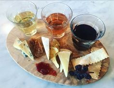 - White wine + blue cheese + fig Wine pairings: - Rosé + brie + California Apple Crisps - Red wine + parmesan + isabella grape raisins + crackers with a side of strawberry jam.