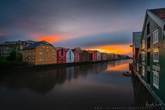 Trondheim and its dramatic mood! - website:www.aziznasutiphotography.com               At Nidelva's outlet there have been seaside stalls, breweries and warehouses all the way from the oldest times. Here the towners traded with goods from far and near. Picture has been taken before the rain when colors were very strong and punchy!