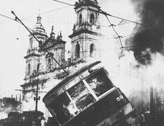 Bogotá (Colombia) on fire during the April 9th 1948 riots. Jorge Eliécer Gaitán, a highly charismatic presidential candidate, was shot at 1 PM on April the 9th 1948. Crowds of supporters, most of them from a very poor background, started a chaotic  series of riots that destroyed a large part of the city's downtown. Gaitán was a member of the Liberal Party, and his assassination is believed to have sparked a long period of partisan violence.