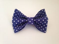 Adorable cat or small dog bow tie that slips onto your pets current collar. Give your pet a smart new look for a special occasion - or just have some fun! Hand-sewn from 100% cotton fabric. No glue used in the manufacturing of this product. The bow tie modeled by my cat is attached to a matching fabric. You can purchase the bow tow with a built in strap and velcro fastening in a different listing. For reference, my cat is quite large (8kg). Bow length is approx 9cm and height 5.5cm. The…