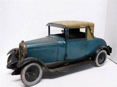 Citroen Six Coupe from about 1927.  These models of Citroens were made at the Citroen Factory. It is pressed steel, about 15 inches long. The front wheels steer and the doors open.  The eBay price is $3,500.00 with six offers.