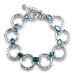 Silver Circle Bracelet - Swiss Blue Topaz bracelet in Solid Silver Solid Silver circle bracelet with 7 oval Swiss Blue topaz cabouchons mm) and fob. Topaz Gemstone, Fine Jewelry, Jewellery, Silver Hoops, Blue Topaz, Handcrafted Jewelry, Solid Gold, Garnet, Turquoise Bracelet