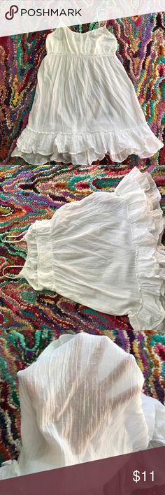 Adorable linen sundress! Great condition! White linen material with ruffles along the skirt and eyelet lace along the empire waist. Adjustable straps. From Old Navy Intimates, so it can be worn as a nightgown as well. However, I always wore it as a sundress. A slip is needed to wear with this! Old Navy Dresses