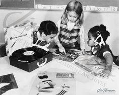 Children enjoy Sesame Street records in this 1974 promotional shot.