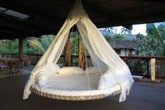 Pretty cool recycle idea? Outdoor hanging lounge area... made out of an old TRAMPOLINE.
