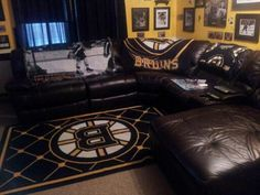 Bruins themed room. a room just to watch hockey