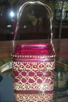 Hot pink hanging square candle holder with hand painted gold Moroccan lantern design...Lovely