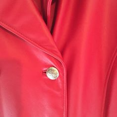Amazing RED Leather Jacket - Like New Beautiful amazing color red leather jacket.  Like new condition!!  This Jacket will more than likely be hip length on you. Detailed on the front with six beautiful brass decorated buttons. Has a pocket on each side.  The beautiful rich red color is hard to show in photography. The last photo show the jacket in regular light. The first two photos shows sunlight on the jacket. The photos with the sun on it looks more a bright lipstick red. Gorgeous!  100%…