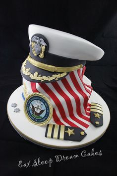"2011 - A cake to celebrate a US naval Officer's promotion to Commander. 11"" & 7"" base cakes with a carved 9"" and 7"" cake cap. All mud cake with Dark Chocolate Ganache"