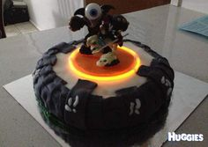 Skylanders Portal birthday cake. This is my DS 7th birthday cake earlier in the year. It was his idea to add the glow sticks to make the portal light up. The look on his face was so worth the struggle to make it (it was my first attempt at fondant). Thank you Cakes To The Rescue for the kit to make it myself.