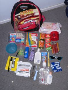 Cute bug out bag. Ours have a change of clothes, water bottle, first aid kit, toiletries, emergency numbers and change, different games, snacks, notebook and paper. Toss the survival fanny pack in the adult bag.