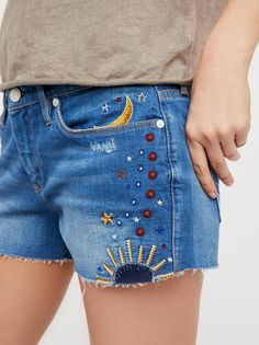 Chain Toker Embroidered Short | Classic denim cutoffs with cute embroidered moon, sun and galaxy-inspired accents allover.   * Frayed hem * Zip fly * Five pocket design