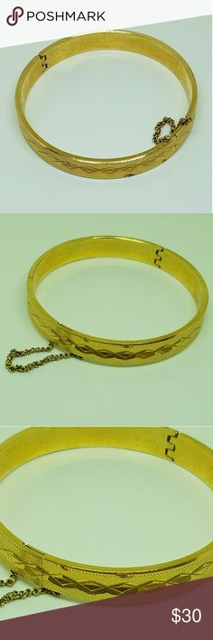 Vintage Gold Hinged Bangle Bracelet Midcentury Modern bangle with hinge for easy on off and a safety chain. It has a classic geometric diamond cut pattern and is probably gold plated but I could find no marks. In very good vintage condition. This is not new and may have slight wear but that adds to the vintage look. The clasp is working and the chain secure. Jewelry Bracelets