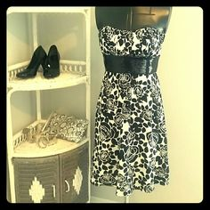 Black and white dress with sequins Perfect party dress.  Strapless with padded bra cups, so no strapless bra needed (yay!)  black sequin band below bust dresses it up.  Knee length or just below depending on height.  Gorgeous ruching on bustling.  Shoes and purse in photo also available in my closet if you need accessories White House Black Market Dresses
