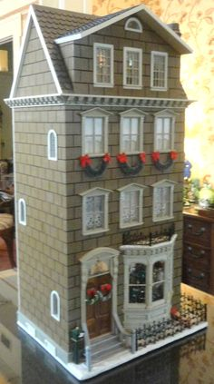 Dollhouse decorated for Christmas!!! Bebe'!!! Love this festive doll house!!!