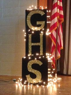Large boxes painted black, lettered in Eileen's tacky glue then covered with gold glitter. Gave our stage a little extra school spirit for our black and gold themed prom! (spirit week ideas for teens) Black And Gold Party Decorations, Black And Gold Theme, Black Gold Party, School Dance Decorations, Banquet Decorations, Graduation Decorations, Dance Themes, Prom Themes, Graduation Party Decor