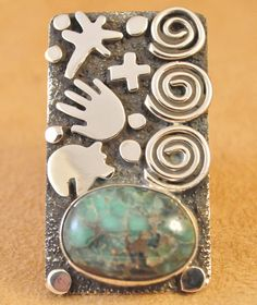 Handmade contemporary ring, with natural rare Damele, by Navajo artist Alex Sanchez.