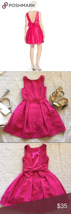 NWT: Soprano Bow Back Fit & Flare Dress, sz XS NWT: Soprano Bow Back Fit & Flare Dress in a bright pink, pleated full skirt with a low back and a show-stopping bow. This is brand new, never worn, from a smoke-free/pet-free home. Size: XS (juniors) Soprano Dresses