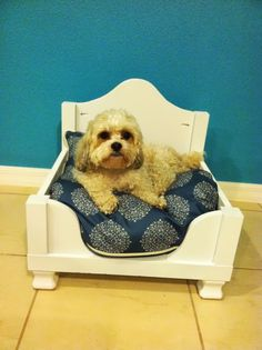 Turn an Ikea Lack side table into an adorable dog or cat bed. A great DIY hack.