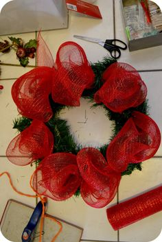 I know that these wreaths are not new, but this is the first time I have attempted to make one. I was so tired at looking at our old wr...